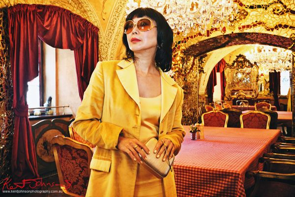 Fashion lifestyle shot with model in the baroque inspired Italian dining room, Prague. Boutique Hotel photography in Prague by Kent Johnson.