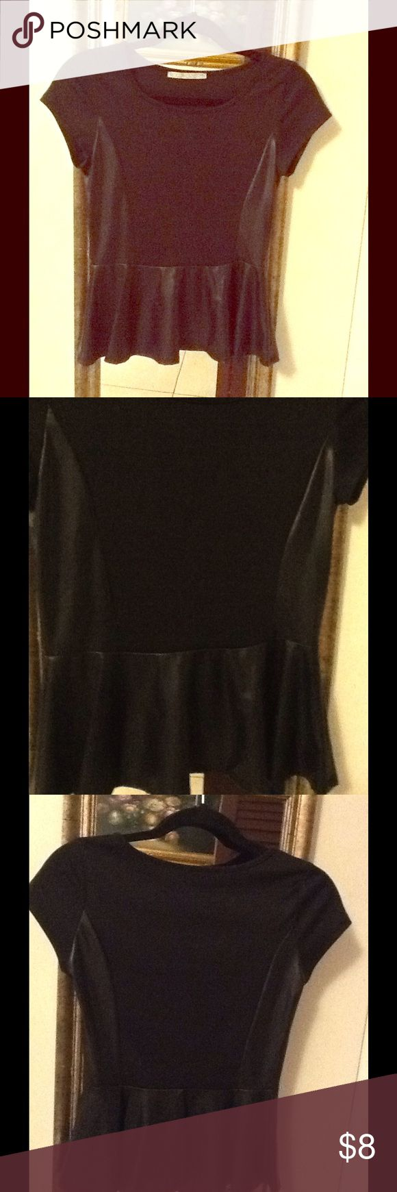 Black short sleeve stretch faux leather peplum top Black short sleeve stretch faux leather peplum top. Polyester stretch. In great condition. Worn once. Thanks ♥️ Tops