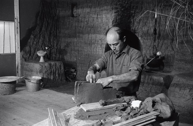 #tbt Noguchi working on ceramic #sculpture in his studio in Kita Kamakura, Japan, where he took up residence in the early 1950s, newly married to Yoshiko Yamaguchi and under the mentorship of master potter Rosanjin Kitaoji. #Noguchi was deeply immersed in Japanese traditions and aesthetics during this period, though the #ceramics he created were unlike any that had been seen. Works from this era now #onview in #FunctionalCeramics. Photo: ©The Isamu Noguchi Foundation and Garden Museum…