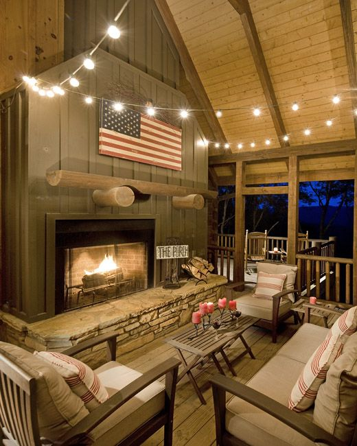 The side porch fireplace is used all year long, not just cold nights.  For more photos and to download floorplans: http://www.modernrustichomes.com/design/portfolio/chestnut-lodge