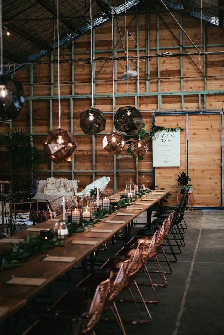 warehouse wedding with modern copper and black industrial furniture and lighting