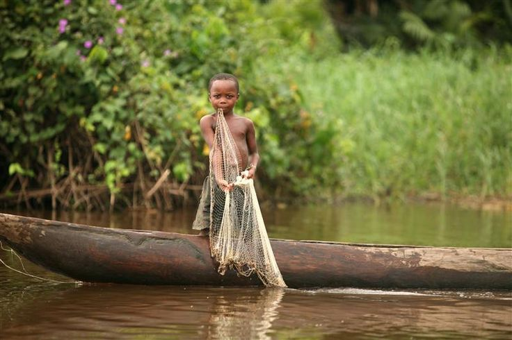 Young Boy Fishing in the Congo -  A Congolese boy is trying to catch fish for the family in a village along the Congo River. © Greenpeace / Jiro Ose