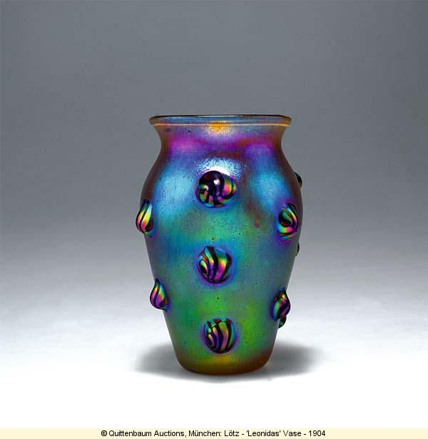 Loetz Leonidas vase, 1904. Candia Silberiris ground with dense application of silvery yellow granules and strong matte mother-of-pearl luster; applied deep purple shells with silver-yellow stripes.