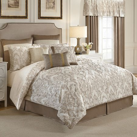 The Madeline Bedding Collection exudes elegance in soft ivory and warm taupe shades. The comforter and shams feature embroidered damask both trimmed with ...