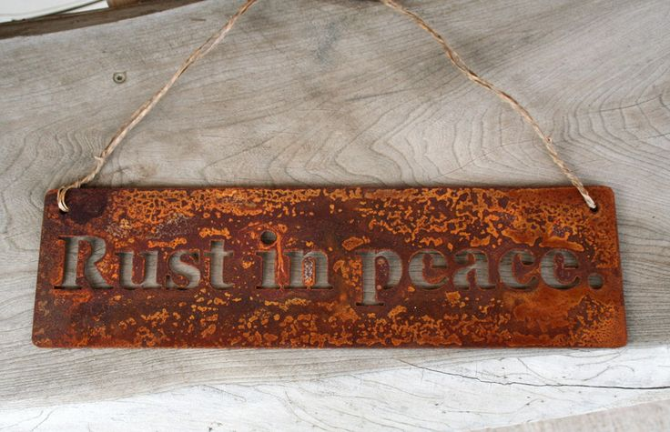 "Rust in peace. Metal Garden Hanger. Rust in peace. Rusted steel sign adds charm to your garden! Funny metal sign finds its place in any home or landscape. This rusted sign is cut from steel just thinner than a nickel. The funny sign is sturdy yet lightweight! Your ""Rust in peace"" sign will arrive pre-rusted. It will continue to age and patina with time outdoors. This adorable garden sign is 14"" wide. It is strung with vine wire. Wire can easily be removed to nail the sign onto a door or..."