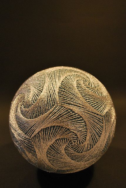Temari, is a Japanese thread ball, which is a symbol of perfection. There is a long history about the weaving of thread to create this artwork....Photo by...Nana Akua.