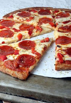 A cheesy low carb and keto pizza recipe for when you're craving pizza. #ketopizza #lowcarbpizza