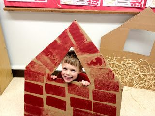 Cardboard houses for story retelling of the 3 Little Pigs.