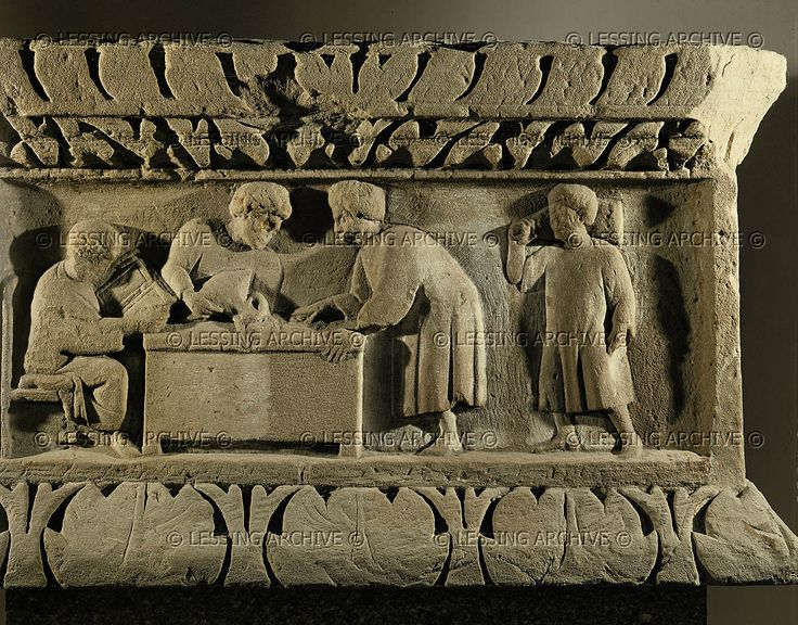 Tax collection scene with four persons. Relief on a funerary stele (2nd-3rd CE). Rheinisches Landesmuseum, Trier.