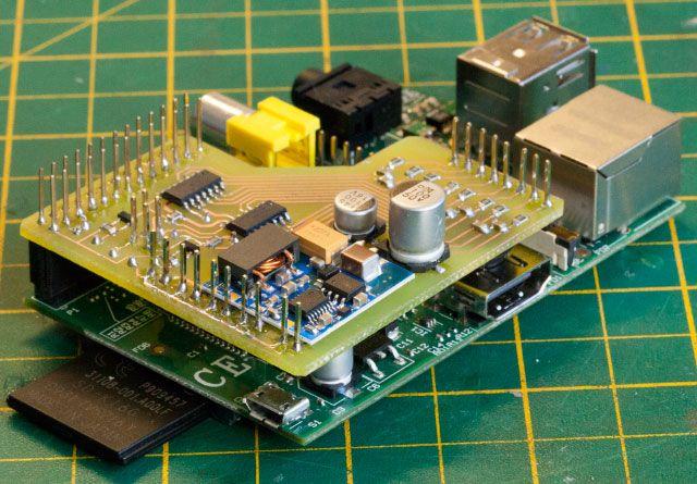 A Raspberry Pi armed with a custom-built I2C analog/digital converter.