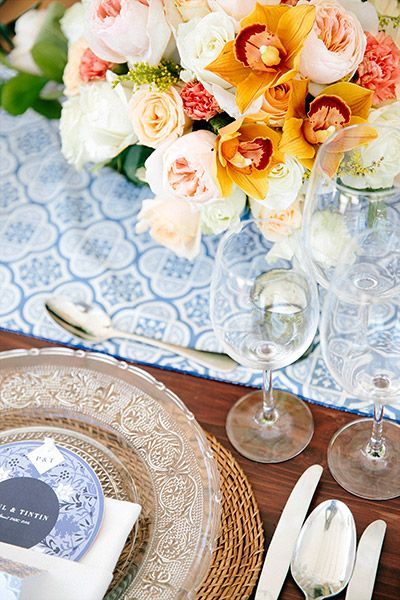 The couple's planners took their cue from Tintin's love of Portuguese Azulejos tiles and ordered stationery, table runners and cushion covers in traditional tile prints, predominantly in blue.