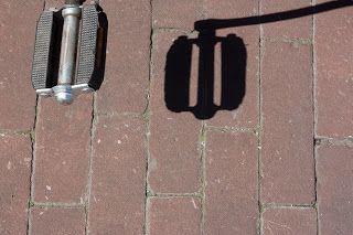 Bike treadle and its shadow.