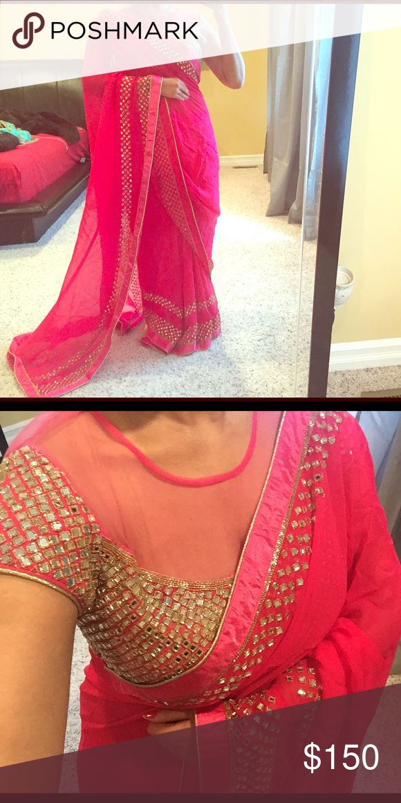 Indian sari Gorgeous hot pink Bollywood style Indian saree. The blouse is the showstopper here - mirror work all over front and back with sheer net neckline.  saree has mirror work border all over. Comes with underskirt/petticoat. Other