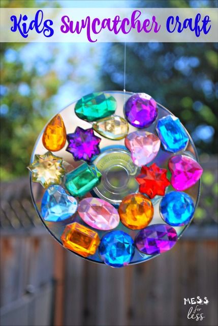 Make a colorful suncatcher craft with kids. This looks pretty when hung outdoors and it serves as a deterrent to birds who may be trying to attack your garden.