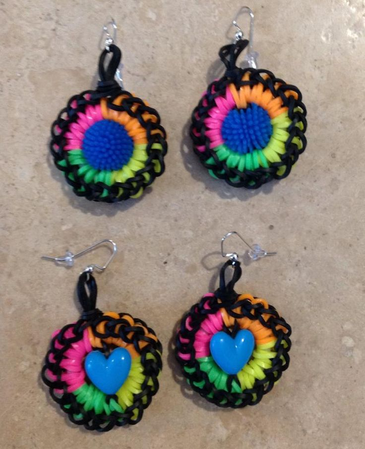 Rainbow Loom SPIRIT EARRINGS. Designed and loomed by Nicole van Hek-Riphagen form the School Spirit Earring tutorial by LoomBandz. Puff Ball beads from Family Dollar store. Nicole used Neon bands. Click photo for the YouTube Loombandz tutorial. 03/03/14