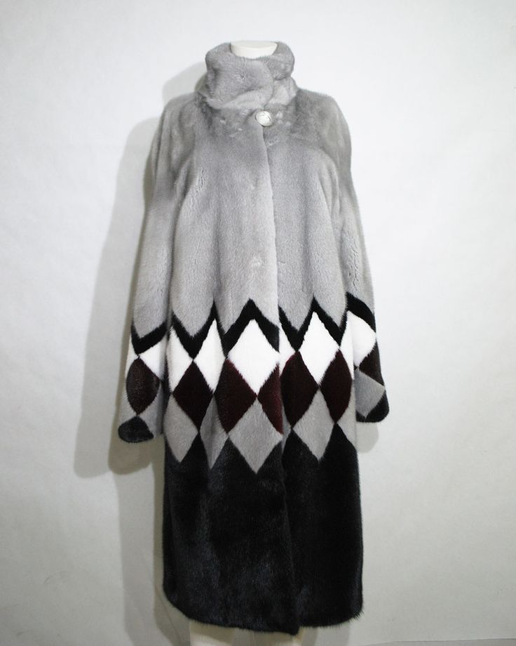 Stand out with a fabulously modern 4-coloured mink fur coat.