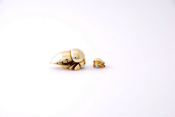 """Platebugs. Miniatures made from brass. Big 2,5 x 2 x 3,5 cm. Small 1,3 x 1 x 1,5 cm.  """"The same thing we do every night Pinky. Try to take over the world!""""  Photo: Hanna Silander"""