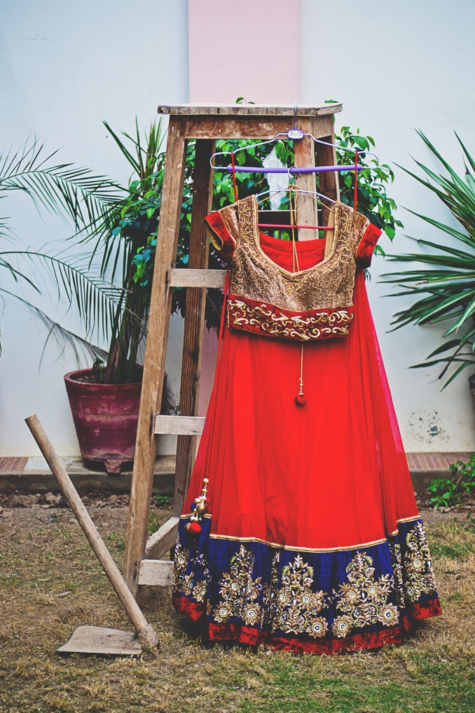 Red, gold, and blue lengha
