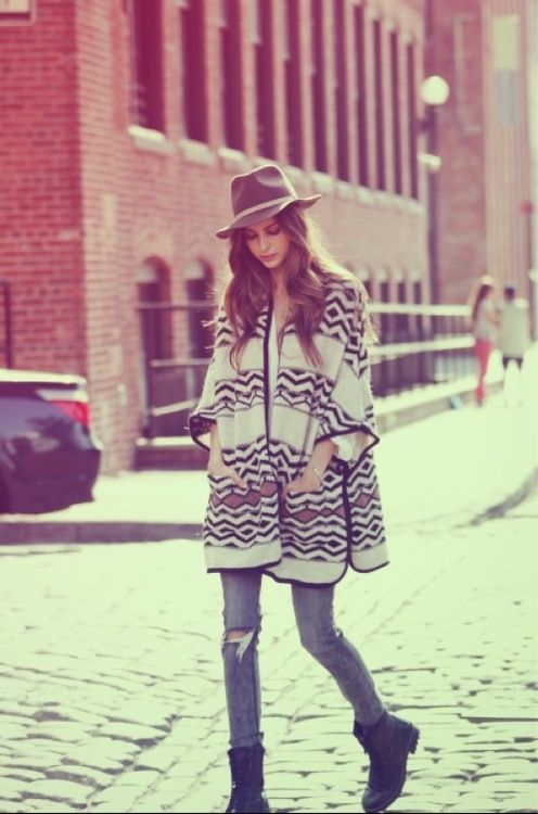 Love the whole outfit, from hat, great patterned poncho, ripped skinny jeans, to ankle boots