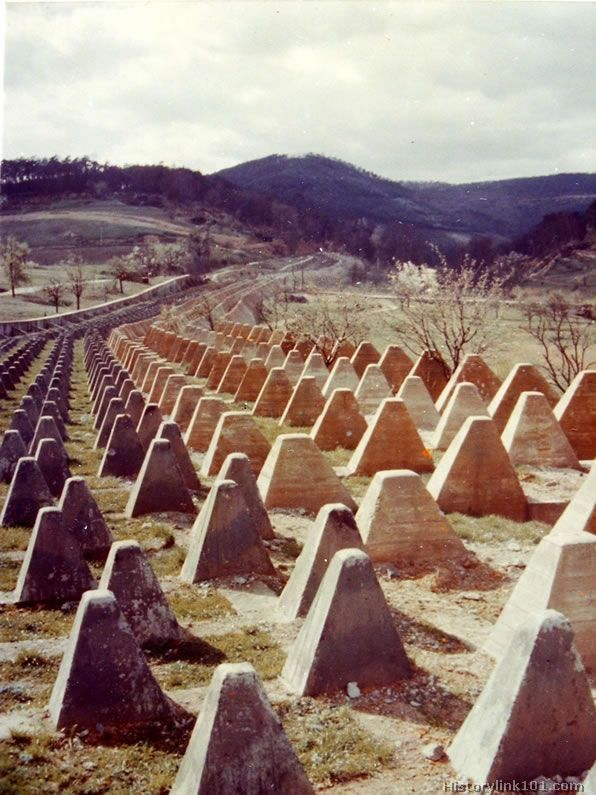 """""""Dragon's Teeth"""" of Siegfried Line running to the mountains where the terrain becomes the tank block."""