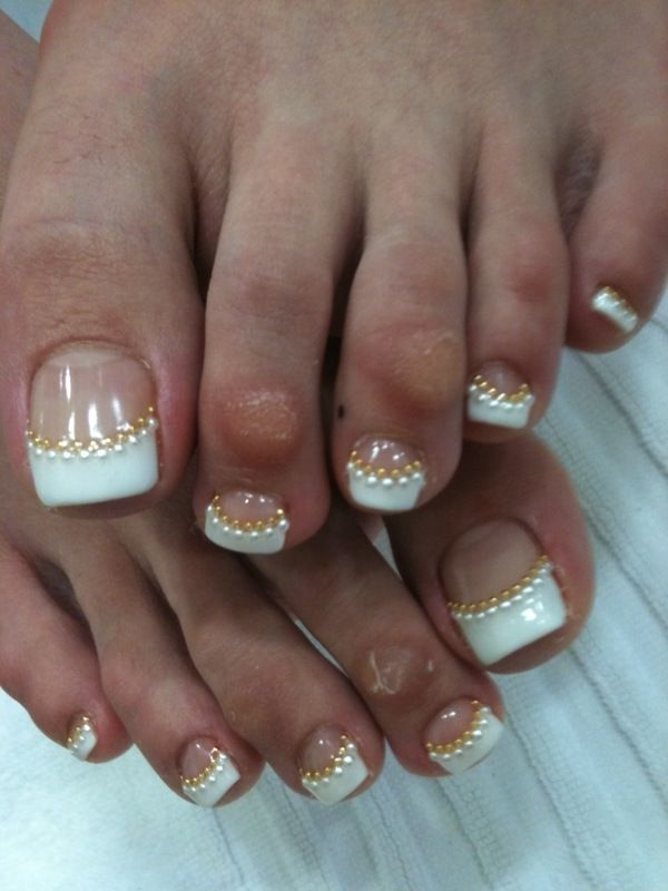 White french manicure style tips with 2 color metallic caviar on the smile line - free hand pedicure nail art. But the toes are uhhh...ummm a little busted (can you say....well, fitting shoes?) I personally don't think I'd display MY  nail art on those crunchy toes.......but hey, the nail art is on point!