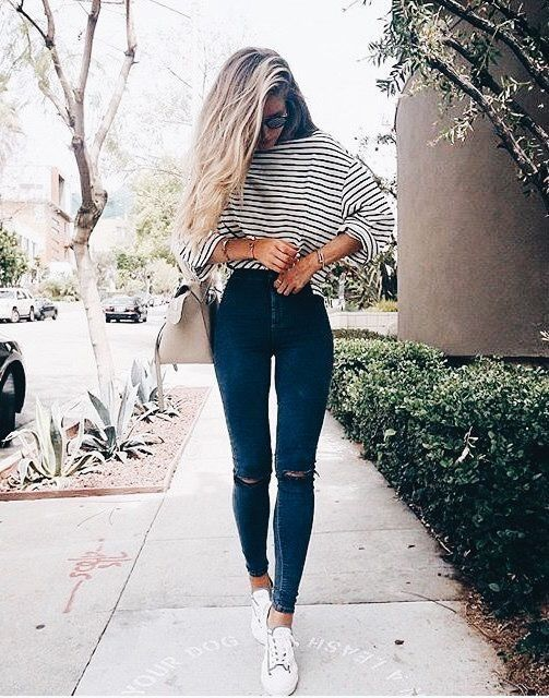 Striped top with blue skinny jeans.
