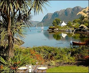 Plockton Bay, is on the train route from Dingwall To Kyle of Lochalsh in the Scottish Highlands.  This bay is so protected the locals grow palm trees along the shore.