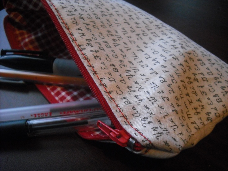 Zipper pouch made from fabric I printed myself using freezer paper (Cursive letters printed on cream quilting cotton)