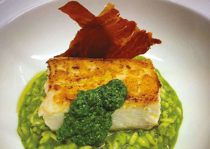 Pan-fried halibut with basil pesto risotto and crispy prosciutto. Follow link for full recipe from Appetite Magazine, North East England's dedicated food & drink publication.