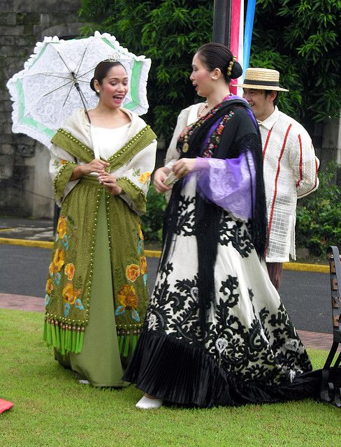 Women in traditional costume strolling in Intramuros walled city in Manila.