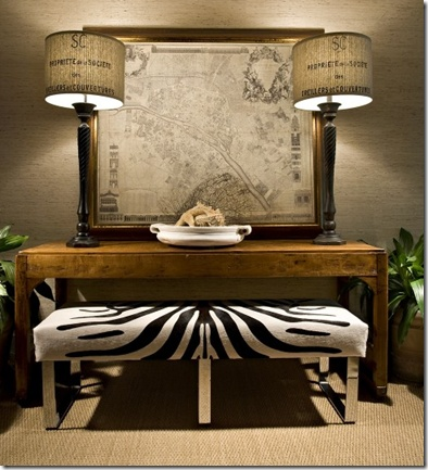 Love the tall lamps, framed map, and hide-upholstered mod bench.