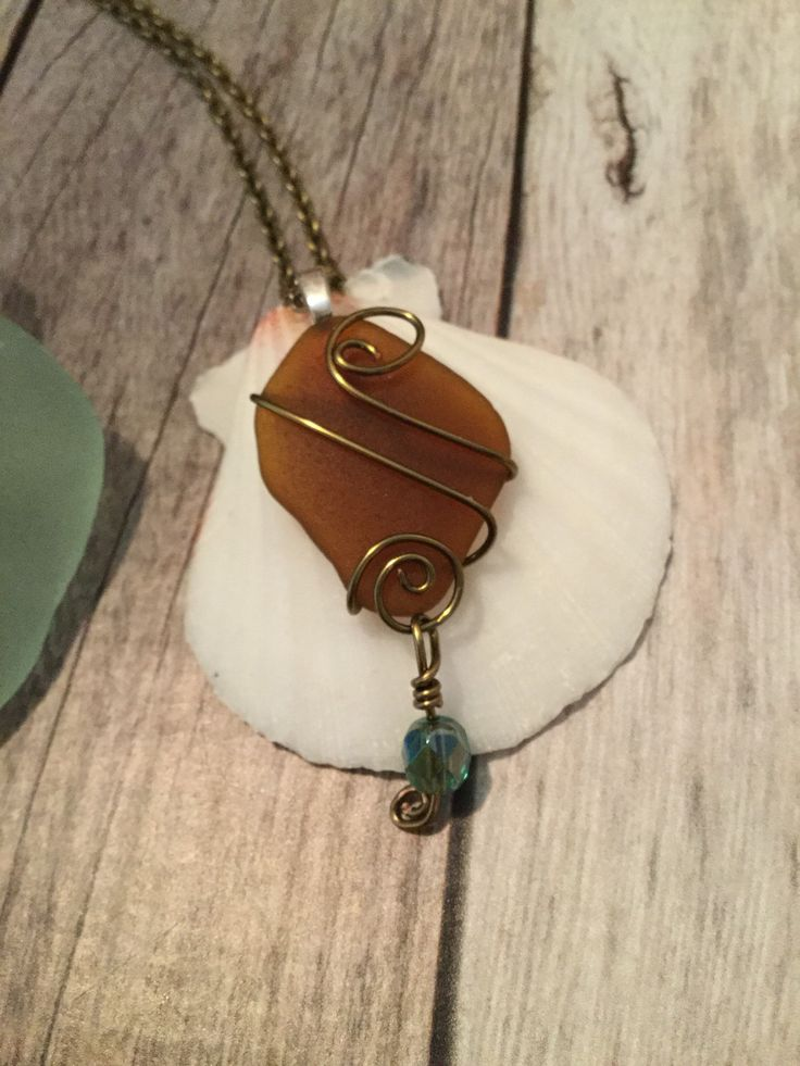 Beautiful Wire Wrapped Sea Glass by JNsArtnTreasures on Etsy https://www.etsy.com/listing/587404200/beautiful-wire-wrapped-sea-glass