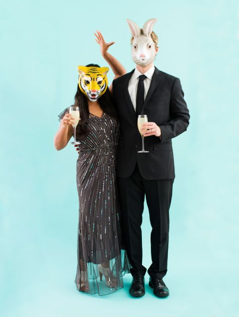 "File this ""Party Animals"" costume under ""easiest Halloween costumes to put together at the last minute"" — just pick up a pair of animal masks and put on your best duds. Click through for more on this and other Halloween costumes for couples."