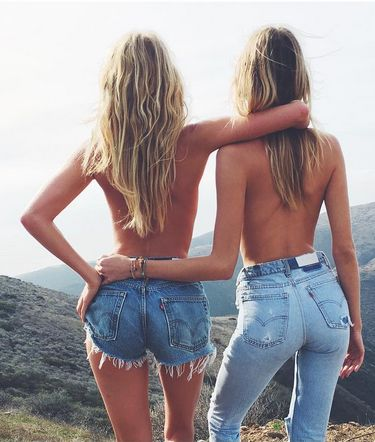 What a view. Models Elsa Hosk andMartha Hunt wear vintage 501 jeans and denim shorts by RE/DONE. Photo by Guy Aroch, Styling by Liz Mcclean.
