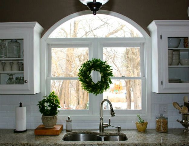 arched window over sink redecorated kitchen