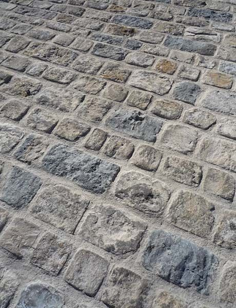 Vernet Rustic Cobblestone gives a rougher surface choice. Limestone pavers shown installed in a patio.