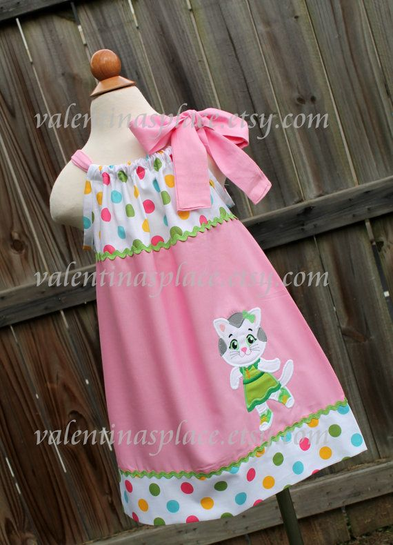 A beautifull and adorable Katarina from Daniel Tigers Neighborhood character in pillowcase dress in a white and polka dot pastel colors and solid