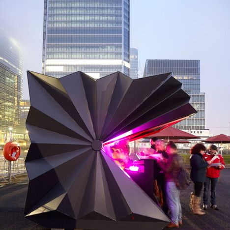 Folded metal kiosk by Make: London architecture office Make has designed a portable prefabricated kiosk with a folded aluminium shell that opens and closes like a paper fan. Make based the design of the kiosks on the folded paper forms of Japanese origami, but chose to reproduce them in metal to create a compact and robust structure that can house street vendors.