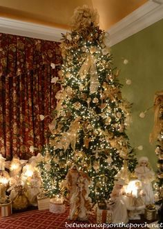 Breathtaking Christmas Tree with an angel theme | Photo by Susan (BNOTP) with Pin-It-Button on http://betweennapsontheporch.net/tour-a-beautiful-victorian-home-decorated-for-christmas-part-v/