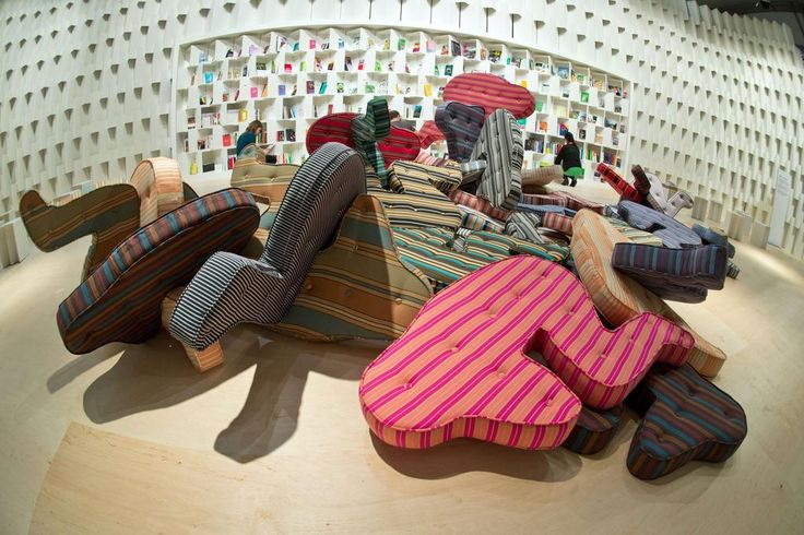 Mattresses shaped like laying persons are seen at the booth of Brazil at the…