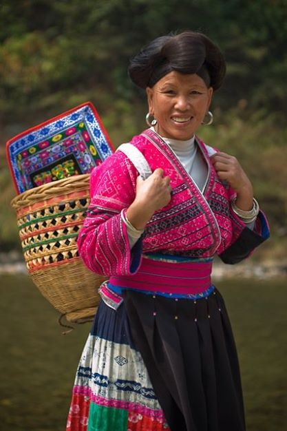 A woman from Huangluoyao Village, located inside the Longji Scenic Area, Guianxi Province  www.mikehollman.com
