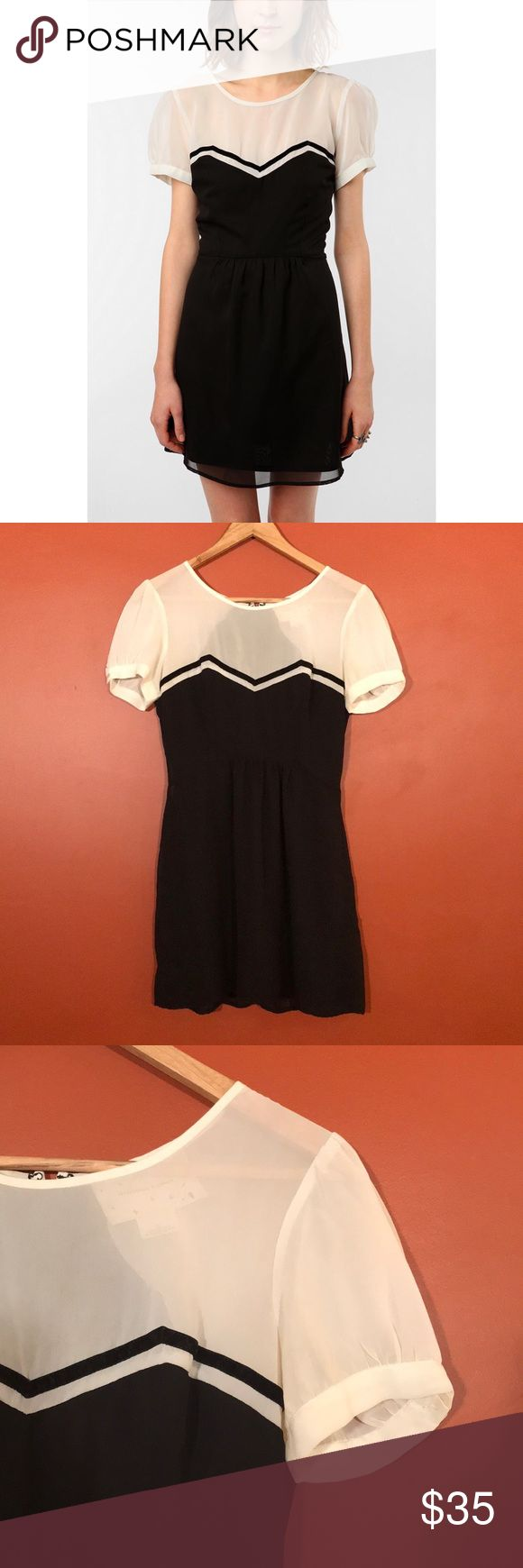 "Urban Outfitters Coincidence & Chance B&W Dress Urban Outfitters Coincidence & Chance Black & White Dress with velvet ribbon detail across chest. Puff sleeves. Lined. Great condition. Chest 18"", length 32"". Urban Outfitters Dresses Mini"