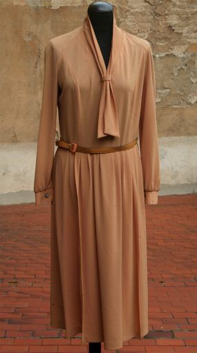 Original 1970s dress with long sleeves with press-stud closure, skirt with pleated detail and collar neckline with bow tie and hip belt at waist