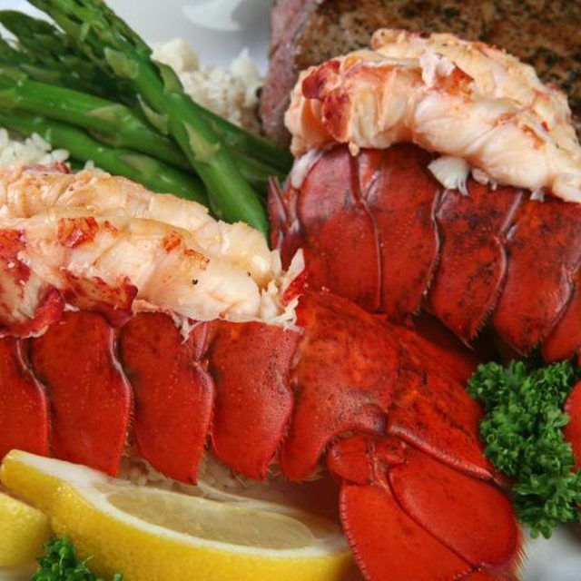 Keep grilled petite lobster tails succulent by brushing with butter or oil.