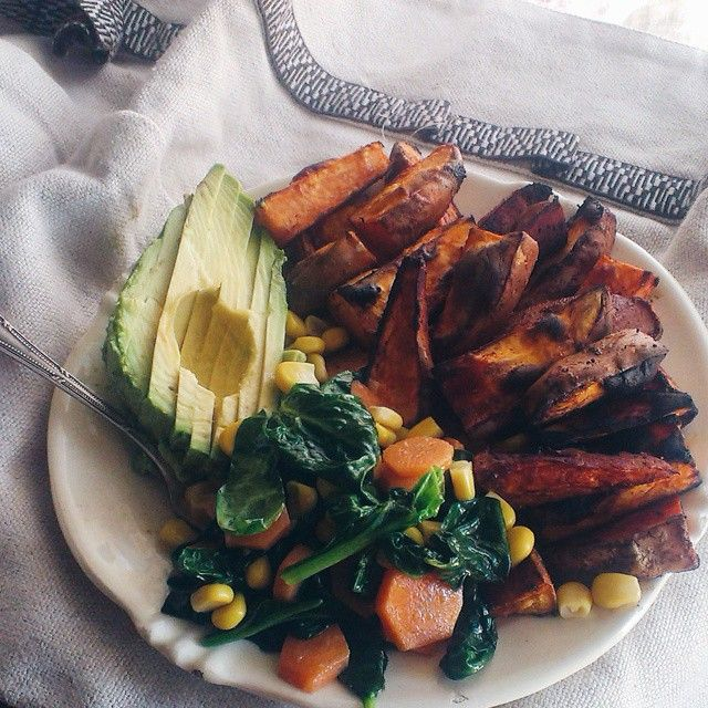 Yumminest lunch ever. Baked sweet potatoes with paprika and garlic, spinach with carrot and corn and a beautiful avocado