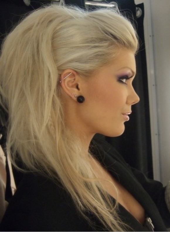 Faux hawk ponytail and rock star makeup. Love it.
