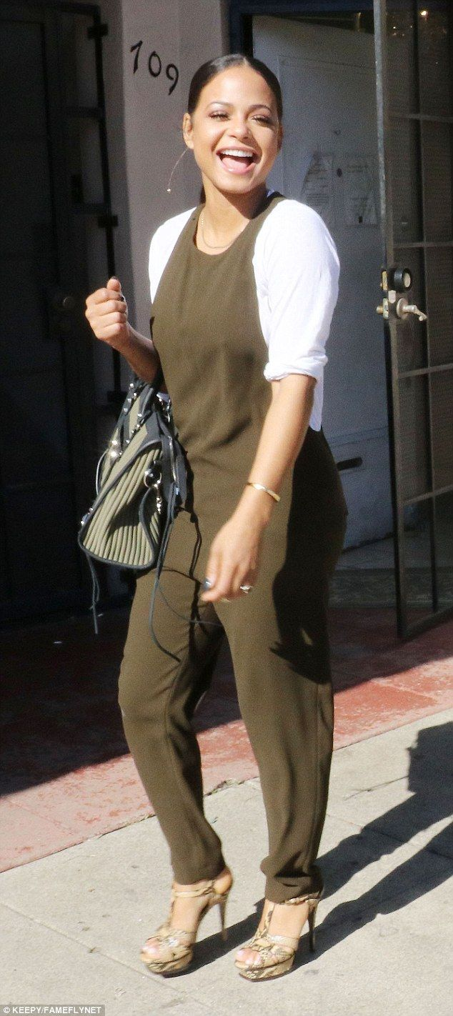 Having a laugh: Christina Milian put on a playful display for the cameras during an outing in West Hollywood today