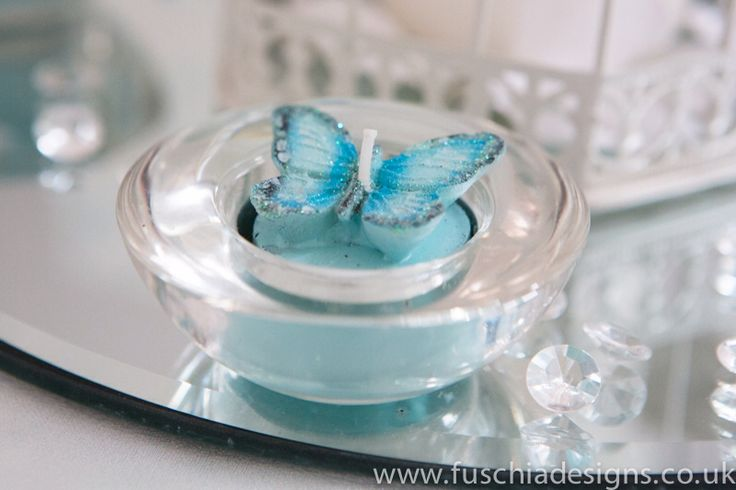Butterfly wedding tea light a great addition to your table. www.fuschiadesigns.co.uk