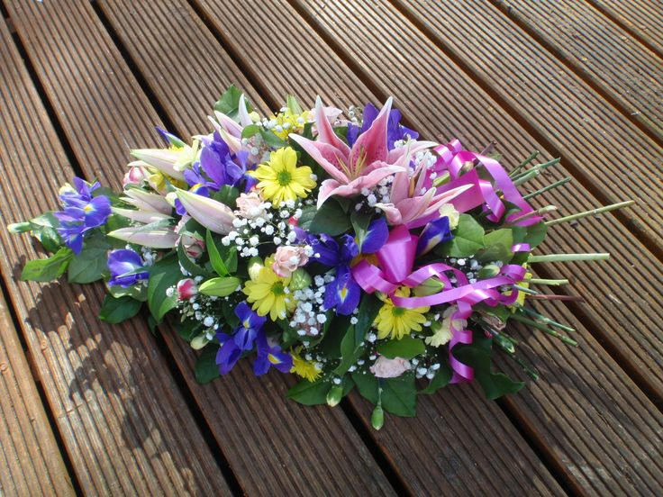a single ended spray with stems/stalks made up of spring colours