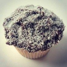Lamington- Vanilla bean sponge w Raspberry conserve filling dark choc ganache & coconut